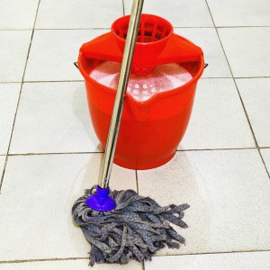 My favorite tip for cleaning kitchen floors by mopping with vinegar. One of my favorite kitchen floor cleaning hacks!