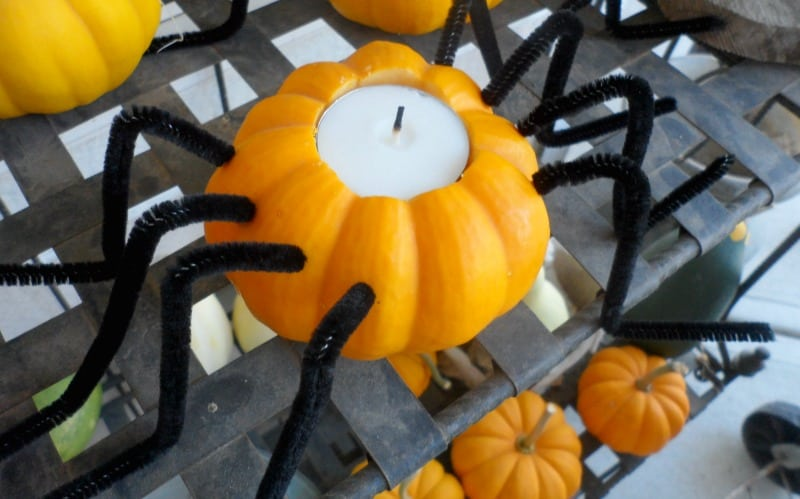 Easy pumpkin spider candle holders to make for your front porch for Halloween.