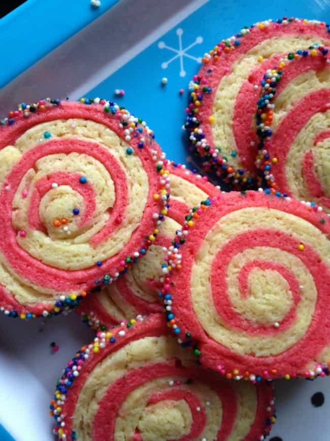 These pinwheel cookies are a fun holiday recipe to make for Christmas or any time of year. Just change the color to match your party theme.