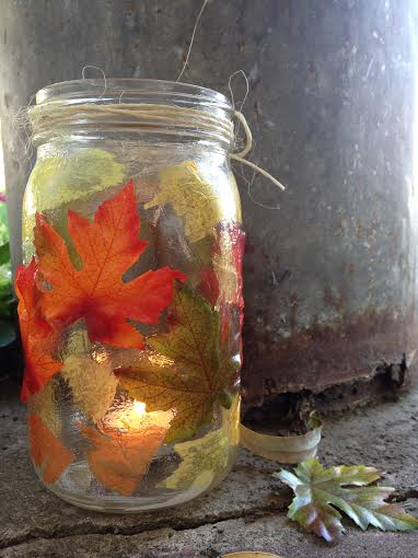 Easy DIY fall craft. How to make fall leaf mason jar candle holders.