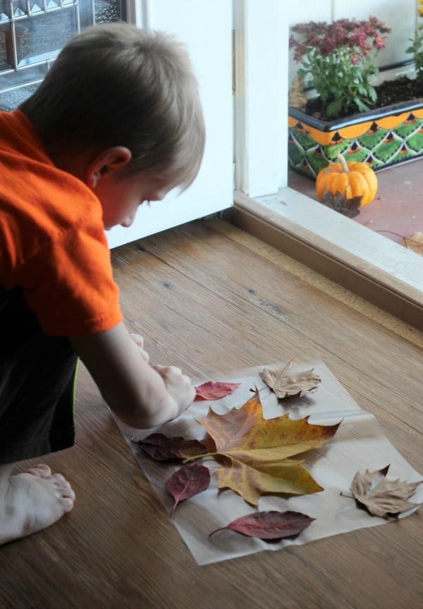 Placemats made from fall leaves are a fun Thanksgiving craft activity for preschool and kids of all ages.