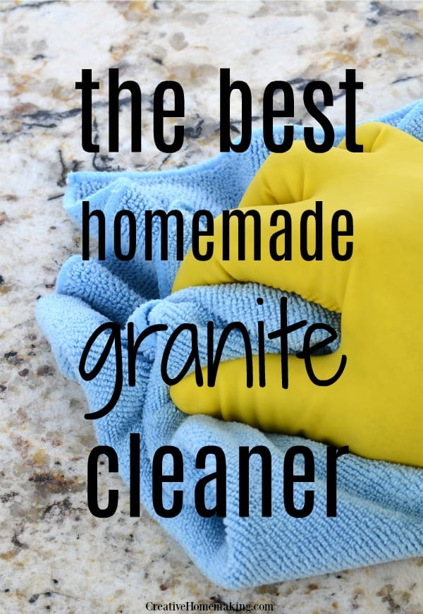 Photo of person cleaning a granite kitchen countertop