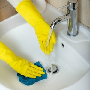 Expert tips for removing hard water stains from kitchen and bathroom sinks.