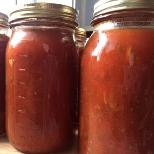 Extra tomatoes from your garden? Try making and canning homemade spaghetti sauce.