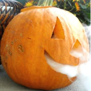 This smoking dry ice pumpkin is a fun decoration to surprise your trick-or-treaters with for Halloween.