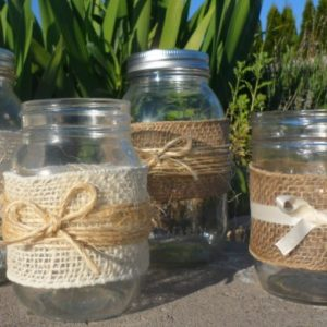 Creative ways to decorate inexpensive mason jars to use as centerpieces for your party or wedding reception.