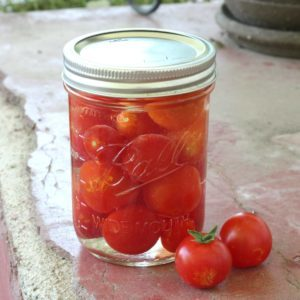Recipe for making and canning pickled cherry tomatoes. Add pickled tomatoes to pasta salads or eat right out of the jar! Easy recipe for beginning canners.