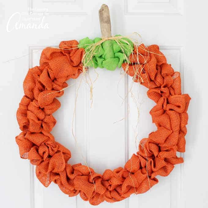 Easy DIY burlap pumpkin fall wreath to hang on the front door.
