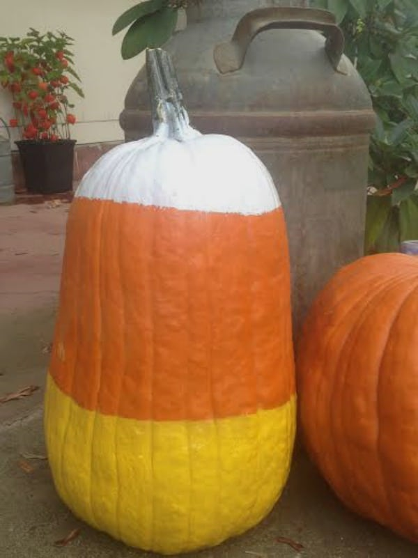 Easy candy corn pumpkin you can paint to decorate your front porch for fall or Halloween.