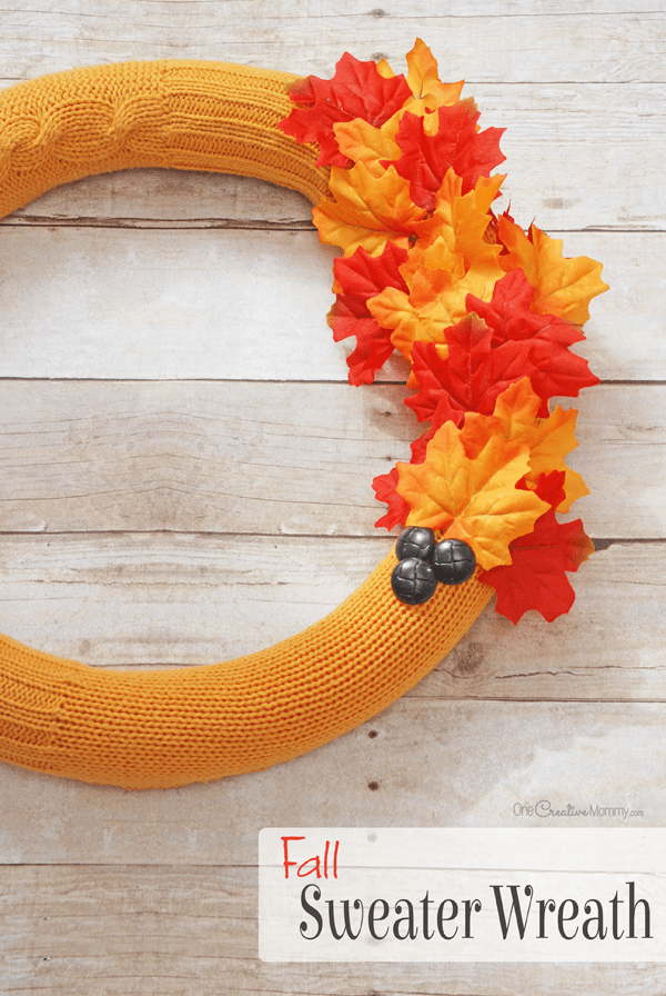 Easy cozy sweater pool noodle fall wreath to hang on your front door.