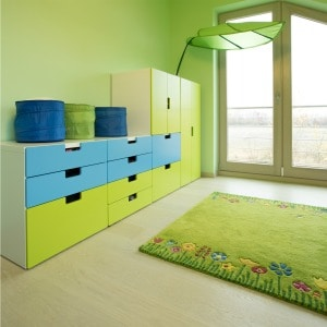 Child's play room decorated with green throw rug