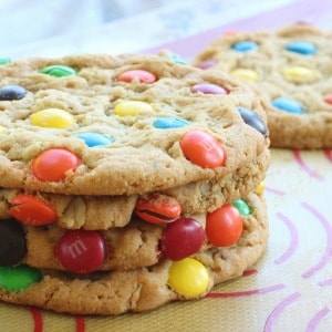 The BEST giant soft M&M cookie recipe. A secret ingredient makes them turn out perfect every time. My favorite giant cookie recipe!