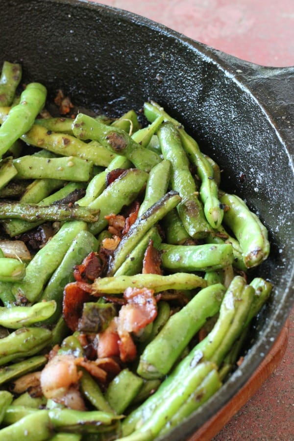My favorite recipe for easy sauteed green beans with bacon and onions, a great vegetable side dish to serve with chicken, steak, or pork.